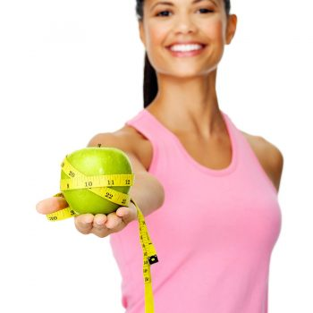 Weight loss picture with a girl holding an apple
